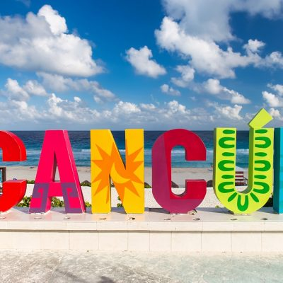 Cancun Mexico - 12 December 2015: CANCUN inscription in front of the Playa Delfines beach